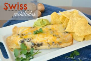 Swiss Enchiladas  have a red sauce and chicken filling with a creamy white sauce on the outside
