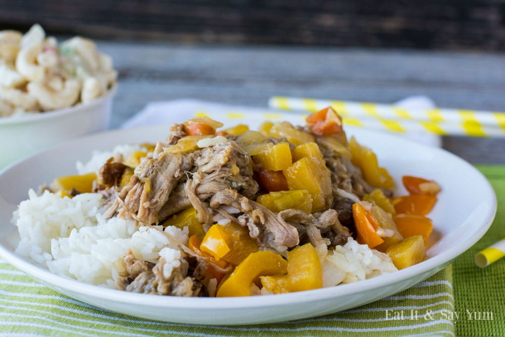 Kahlua Pork with rice and a chunky sauce of peppers, carrots, and pineapple