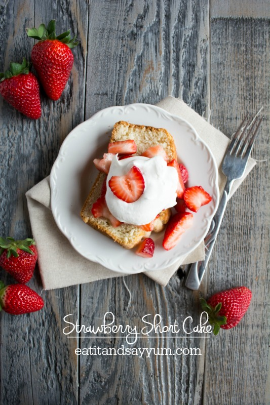 Strawberry Short Cake- a lightly sweetened shortcake with a sugar coating, topped with fresh strawberries and homemade whipped cream