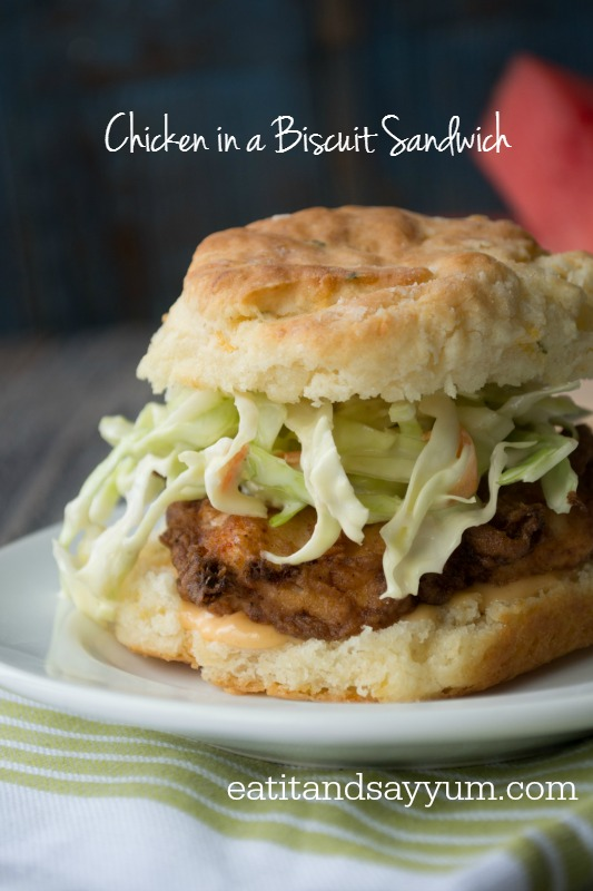 Chicken in a Biscuit Sandwich with coleslaw and Sriracha Honey Mayo