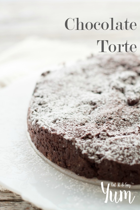 Chocolate Torte - a decadent chocolate dessert- top with whipped cream and berries